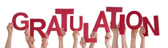 Οι άνθρωποι κρατούν Gratulation ότι του Word σημαίνει τα συγχαρητήρια στοκ εικόνα με δικαίωμα ελεύθερης χρήσης