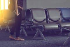 Οι άνθρωποι πηγαίνουν στο κάθισμα αερολιμένων Στοκ Εικόνα