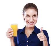Οι αντίχειρες επάνω πίνουν το πορτοκάλι Στοκ Εικόνα