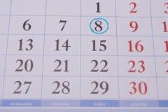 Οι αριθμοί στον μπλε κύκλο στο ημερολόγιο Στοκ Φωτογραφίες