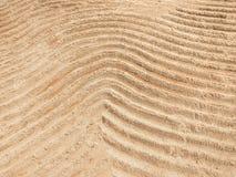 Οι αφηρημένες γραμμές καμπυλών γράφουν στην άμμο Στοκ φωτογραφίες με δικαίωμα ελεύθερης χρήσης