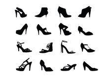 Οι γυναίκες βάζουν τακούνια στις σκιαγραφίες παπουτσιών Στοκ Εικόνες