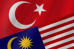 Οι δύο σημαίες χωρών της Τουρκικής Δημοκρατίας και της Μαλαισίας στοκ εικόνες με δικαίωμα ελεύθερης χρήσης