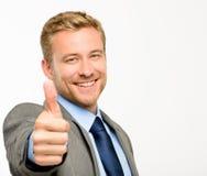 Οι ευτυχείς αντίχειρες επιχειρηματιών υπογράφουν επάνω στο άσπρο υπόβαθρο Στοκ Φωτογραφία