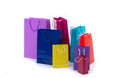 Οι ζωηρόχρωμες και φωτεινές συσκευασίες αγορών για τα δώρα και παρουσιάζουν Στοκ Φωτογραφία