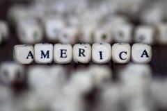 ` Οι ΗΠΑ ` που τυπώνονται επάνω χωρίζουν σε τετράγωνα με στο πρώτο πλάνο και το υπόβαθρο Στοκ φωτογραφία με δικαίωμα ελεύθερης χρήσης