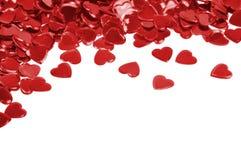 οι καρδιές κομφετί απομόν&o στοκ φωτογραφίες