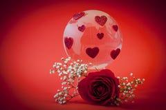 οι καρδιές σφαιρών γυαλ&iot Στοκ Εικόνες