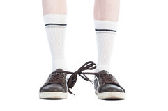 Οι μακριές κάλτσες και οι δαντέλλες παπουτσιών εσύνδεσαν τη φάρσα στοκ φωτογραφίες