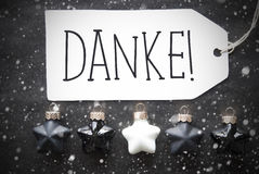 Οι μαύρες σφαίρες Χριστουγέννων, Snowflakes, μέσα Danke σας ευχαριστούν Στοκ Εικόνες