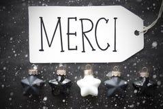 Οι μαύρες σφαίρες Χριστουγέννων, Snowflakes, μέσα Merci σας ευχαριστούν Στοκ Εικόνα