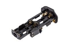 Οι μπαταρίες προσαρμοστών AA για την μπαταρία χειρίζονται τη σύγχρονη κάμερα DSLR Στοκ Φωτογραφία