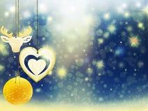 Οι μπλε χρυσές κίτρινες διακοσμήσεις αστεριών χιονιού ελαφιών σφαιρών καρδιών Χριστουγέννων υποβάθρου θολώνουν το νέο έτος απεικό Στοκ Εικόνες