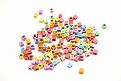 οι ομάδες δεδομένων ανασκόπησης αλφάβητου απομόνωσαν το λευκό Στοκ Εικόνες