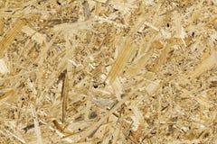 Οι πίνακες OSB αποτελούνται από τα καφετιά ξύλινα τσιπ στοκ φωτογραφία με δικαίωμα ελεύθερης χρήσης