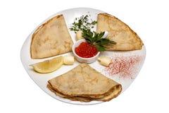 Οι ρωσικές τηγανίτες με το χαβιάρι Στοκ Φωτογραφίες