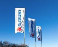 Οι σημαίες με το έμβλημα Suzuki Στοκ Εικόνες