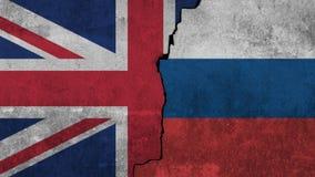 Οι σημαίες του Ηνωμένου Βασιλείου και του Ρώσου χρωματίζω στον τοίχο στοκ φωτογραφίες