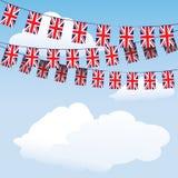 οι σημαίες υφάσματος ανυψώνουν την ένωση με γρύλλο Στοκ Εικόνα