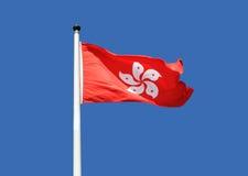 Οι σημαίες Χονγκ Κονγκ κυματίζουν στο αεράκι Στοκ εικόνα με δικαίωμα ελεύθερης χρήσης