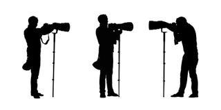 Οι σκιαγραφίες φωτογράφων θέτουν 2 Στοκ εικόνες με δικαίωμα ελεύθερης χρήσης