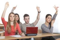 Οι σπουδαστές βάζουν επάνω τα χέρια τους Στοκ φωτογραφία με δικαίωμα ελεύθερης χρήσης