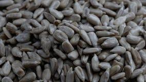 Οι σπόροι ηλίανθων - ένα από το υγιέστερο πρόχειρο φαγητό εσείς μπορούν να φάνε απόθεμα βίντεο