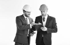 Οι συνέταιροι εξετάζουν την οικοδόμηση του σχεδίου Στοκ Φωτογραφίες