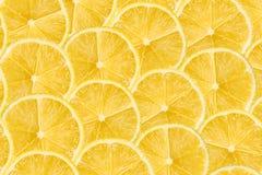 Οι φέτες λεμονιών αφαιρούν το άνευ ραφής σχέδιο Στοκ εικόνα με δικαίωμα ελεύθερης χρήσης