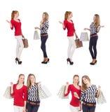 Οι φίλοι με τις τσάντες αγορών που απομονώνονται στο λευκό Στοκ Εικόνες