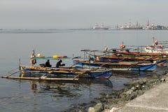 Οι ψαράδες και οι βάρκες τους Στοκ Εικόνα