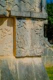 Οι όμορφες χαρασμένες μορφές στο βράχο εισάγονται του Chichen Itza, μια από τις επισκεμμένες αρχαιολογικές περιοχές στο Μεξικό Στοκ Εικόνα