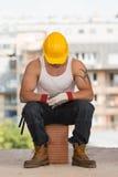 Οκνηρό άτομο στην κατασκευή Στοκ Εικόνες