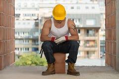 Οκνηρό άτομο στην κατασκευή Στοκ Φωτογραφία