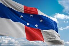 Ολλανδικών Αντιλλών ρεαλιστική τρισδιάστατη απεικόνιση υποβάθρου μπλε ουρανού εθνικών σημαιών κυματίζοντας απεικόνιση αποθεμάτων