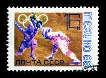 Ολυμπιακοί Αγώνες - περίφραξη, Ολυμπιακοί Αγώνες 1968 - Μεξικό serie, circa 196 Στοκ φωτογραφία με δικαίωμα ελεύθερης χρήσης