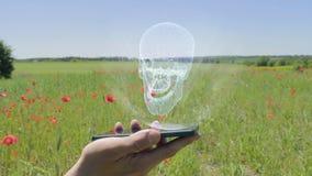 Ολόγραμμα του ανθρώπινου κρανίου σε ένα smartphone απόθεμα βίντεο