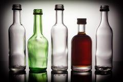 Ομάδα μίνι μπουκαλιών με το σύντομο χρονογράφημα Στοκ Εικόνα