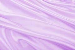 Ομαλή κομψή ιώδης σύσταση μεταξιού ή σατέν ως γαμήλιο υπόβαθρο Πολυτελές σχέδιο υποβάθρου στοκ εικόνα με δικαίωμα ελεύθερης χρήσης