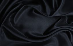 Ομαλή κομψή μαύρη σύσταση μεταξιού ή σατέν ως αφηρημένο υπόβαθρο Πολυτελές σχέδιο υποβάθρου στοκ εικόνα με δικαίωμα ελεύθερης χρήσης