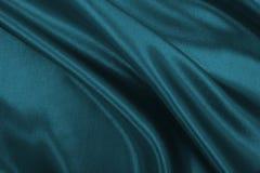 Ομαλή κομψή μπλε σύσταση υφασμάτων πολυτέλειας μεταξιού ή σατέν ως αφηρημένο υπόβαθρο Πολυτελές σχέδιο υποβάθρου στοκ φωτογραφία