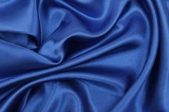 Ομαλή κομψή μπλε σύσταση υφασμάτων πολυτέλειας μεταξιού ή σατέν ως αφηρημένο υπόβαθρο Πολυτελές σχέδιο υποβάθρου στοκ φωτογραφίες με δικαίωμα ελεύθερης χρήσης