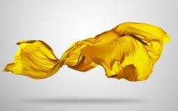 Ομαλό κομψό κίτρινο ύφασμα στο γκρίζο υπόβαθρο Στοκ Εικόνα