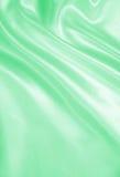 Ομαλό κομψό πράσινο μετάξι ή σατέν ως υπόβαθρο Στοκ Εικόνα