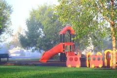 Ομιχλώδες πρωί παιδικών χαρών Στοκ Φωτογραφίες