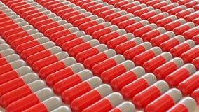 Ομοιόμορφη σειρά κόκκινων και άσπρων χαπιών Στοκ εικόνες με δικαίωμα ελεύθερης χρήσης