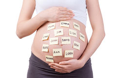 Ονόματα μωρών στην κοιλιά της. Στοκ Φωτογραφία