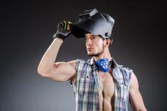 Οξυγονοκολλητής με τη μάσκα ενάντια Στοκ εικόνες με δικαίωμα ελεύθερης χρήσης