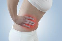Οξύς πόνος σε ένα νεφρό γυναικών στοκ εικόνα