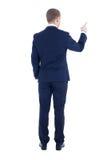 Οπισθοσκόπος του νέου επιχειρησιακού ατόμου που δείχνει σε κάτι το απομονωμένο ο Στοκ εικόνα με δικαίωμα ελεύθερης χρήσης